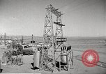Image of Operation Cue electrical transmission tower in blast Nevada United States USA, 1955, second 2 stock footage video 65675063897