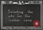 Image of workers fell trees United States USA, 1922, second 2 stock footage video 65675063922
