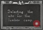Image of workers fell trees United States USA, 1922, second 8 stock footage video 65675063922
