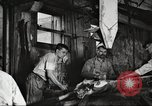 Image of workers in butchery United States USA, 1919, second 4 stock footage video 65675063928