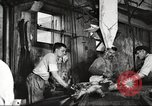 Image of workers in butchery United States USA, 1919, second 8 stock footage video 65675063928