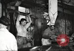 Image of workers in butchery United States USA, 1919, second 6 stock footage video 65675063932