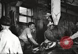 Image of workers in butchery United States USA, 1919, second 8 stock footage video 65675063932