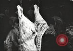 Image of workers in butchery United States USA, 1919, second 2 stock footage video 65675063935