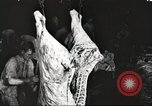 Image of workers in butchery United States USA, 1919, second 7 stock footage video 65675063935