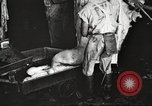 Image of workers in butchery United States USA, 1919, second 9 stock footage video 65675063935