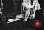 Image of workers in butchery United States USA, 1919, second 10 stock footage video 65675063935