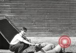 Image of workers in barn United States USA, 1920, second 5 stock footage video 65675063942