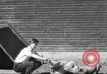 Image of workers in barn United States USA, 1920, second 6 stock footage video 65675063942