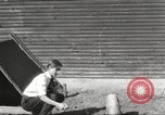 Image of workers in barn United States USA, 1920, second 10 stock footage video 65675063942