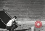 Image of workers in barn United States USA, 1920, second 11 stock footage video 65675063942