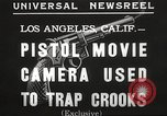 Image of Pistol movie camera Los Angeles California USA, 1935, second 8 stock footage video 65675063945