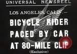 Image of bicycle rider Los Angeles California USA, 1935, second 1 stock footage video 65675063946