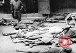 Image of dead bodies Germany, 1945, second 3 stock footage video 65675064121