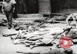 Image of dead bodies Germany, 1945, second 4 stock footage video 65675064121