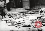 Image of dead bodies Germany, 1945, second 5 stock footage video 65675064121