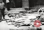 Image of dead bodies Germany, 1945, second 6 stock footage video 65675064121
