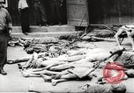 Image of dead bodies Germany, 1945, second 7 stock footage video 65675064121
