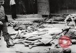 Image of dead bodies Germany, 1945, second 8 stock footage video 65675064121