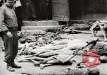 Image of dead bodies Germany, 1945, second 9 stock footage video 65675064121