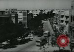 Image of traffic on street Tel Aviv Palestine, 1945, second 2 stock footage video 65675064264
