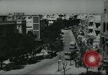 Image of traffic on street Tel Aviv Palestine, 1945, second 4 stock footage video 65675064264