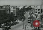 Image of traffic on street Tel Aviv Palestine, 1945, second 9 stock footage video 65675064264