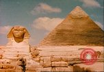 Image of Sphinx guarding Khafre pyramid Egypt, 1951, second 2 stock footage video 65675064341
