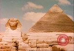 Image of Sphinx guarding Khafre pyramid Egypt, 1951, second 3 stock footage video 65675064341
