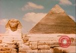 Image of Sphinx guarding Khafre pyramid Egypt, 1951, second 4 stock footage video 65675064341