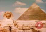 Image of Sphinx guarding Khafre pyramid Egypt, 1951, second 5 stock footage video 65675064341