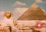 Image of Sphinx guarding Khafre pyramid Egypt, 1951, second 6 stock footage video 65675064341