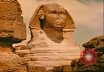 Image of Sphinx guarding Khafre pyramid Egypt, 1951, second 10 stock footage video 65675064341