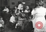 Image of teaching skills to American immigrants in early 1900s Detroit Michigan USA, 1919, second 5 stock footage video 65675064500