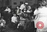 Image of teaching skills to American immigrants in early 1900s Detroit Michigan USA, 1919, second 6 stock footage video 65675064500