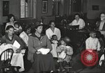 Image of teaching skills to American immigrants in early 1900s Detroit Michigan USA, 1919, second 12 stock footage video 65675064500