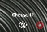 Image of car and motorcycle stunt show Chicago Illinois USA, 1956, second 4 stock footage video 65675064641