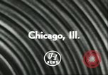 Image of car and motorcycle stunt show Chicago Illinois USA, 1956, second 5 stock footage video 65675064641
