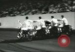 Image of car and motorcycle stunt show Chicago Illinois USA, 1956, second 9 stock footage video 65675064641
