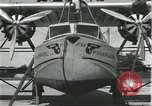 Image of Mechanics work on Consolidated Commodore flying boat Brazil, 1932, second 12 stock footage video 65675064725