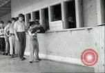 Image of small man Richard Mackey enters Air Force San Antonio Texas USA, 1951, second 9 stock footage video 65675065081