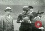 "Image of ""Red Grange"" playing football for University of Illinois Philadelphia Pennsylvania United States USA, 1925, second 7 stock footage video 65675065245"