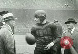"Image of ""Red Grange"" playing football for University of Illinois Philadelphia Pennsylvania United States USA, 1925, second 8 stock footage video 65675065245"