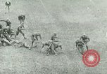 "Image of ""Red Grange"" playing football for University of Illinois Philadelphia Pennsylvania United States USA, 1925, second 12 stock footage video 65675065245"