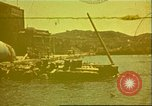 Image of Damaged boats and buildings on coast in World War II North Africa, 1942, second 1 stock footage video 65675065261