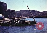 Image of Damaged boats and buildings on coast in World War II North Africa, 1942, second 2 stock footage video 65675065261