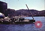 Image of Damaged boats and buildings on coast in World War II North Africa, 1942, second 3 stock footage video 65675065261