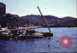 Image of Damaged boats and buildings on coast in World War II North Africa, 1942, second 4 stock footage video 65675065261