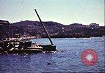 Image of Damaged boats and buildings on coast in World War II North Africa, 1942, second 5 stock footage video 65675065261