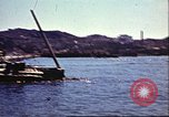 Image of Damaged boats and buildings on coast in World War II North Africa, 1942, second 6 stock footage video 65675065261